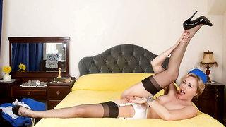 Air Hostess Lucy Lauren masturbates in seamed black nylons