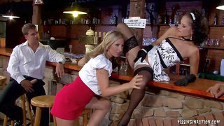 Blonde and brunette are having a foursome in a local bar, with two horny strangers