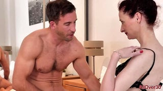 Pale mature woman in black fishnets and garter belt, Scarlet Louise likes to fuck much younger guys