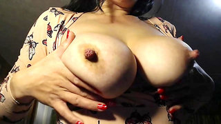 Katrine jiggles her big old titties for us