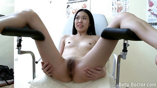 The gynaecologist tests her pussy deeply