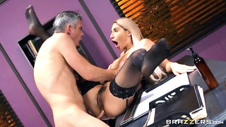 Blonde in stockings sits down on dick on leather couch
