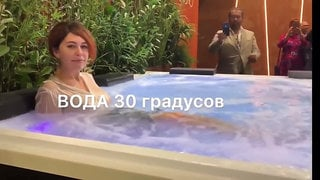 Russian Babe Gets Soaked in Clothes in Public Hot Tub