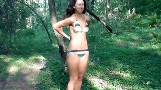 A raven haired girl loses her bikini while out in public and she fucks