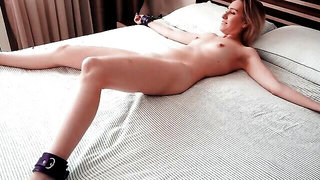 Long-haired stallion is treating his restrained wife with a passionate pussy licking