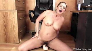 Alicia Silver masturbates with her dildo in office