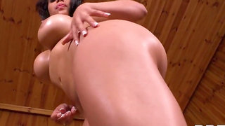 Sweaty and oiled up tanned brunette Kesha Ortega teasing solo in the sauna