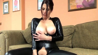 Lavender Rayne is in her catsuit and doing a dildo