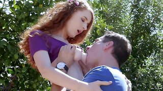 Redhead with pale body Abbey Rain enjoys outdoor fucking