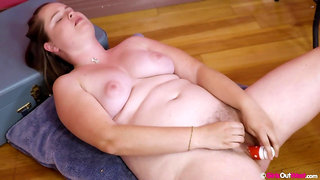 Masturbating her hairy pussy at home