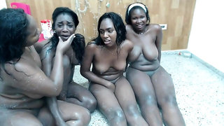 Voluptuous black babes engage in lesbian group sex on webcam