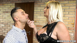 Young bloke fucks old dominatrix in latex