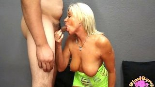 She is a cougar gobbling up a pair of fat peckers