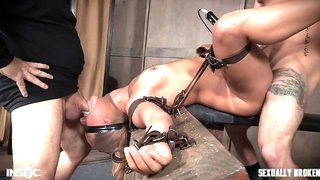 two perverted dungeon masters play with their slave bitch
