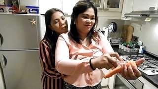 Naughty Asian MILF pisses on her girlfriend in the kitchen