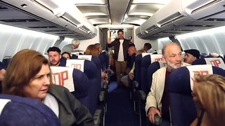 Pilot and a couple of sexy flight attendants fuck on the plane