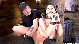 Tied heavy-breasted slave in metal device bondage