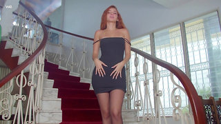 Gorgeous ginger babe Agatha is posing on the stairway