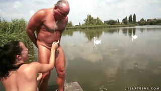 Doll moans in pleasure while getting smashed with a giant cock outdoor