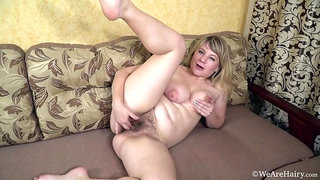 Evlalia masturbates on her couch after undressing
