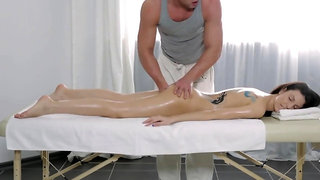Horny therapist is fucking his client during massage session