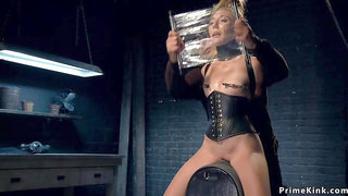 Blonde in leather corset tormented