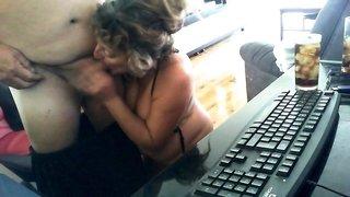 Busty amateur granny delivers a special blowjob on webcam