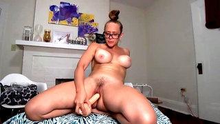 Nerdy MILF Kagney Linn Karter fucks herself with huge dildo
