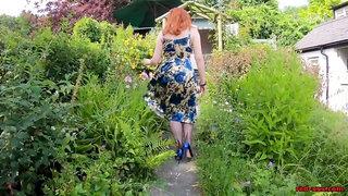 Busty girl Red XXX fingers herself in the garden