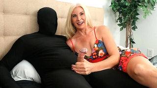 Gorgeous blonde Naughty Jojo strokes a big penis of her boyfriend