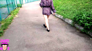 Crazy girl without panties playing hopscotch in public park
