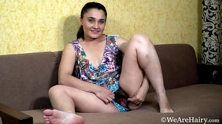 Sanita gets naked and masturbates on her couch