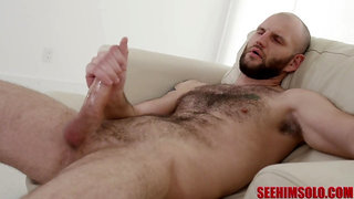 Bearded but bald dude is happy to wank himself till he cums hard