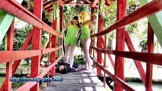 Two girls trampling on the bridge