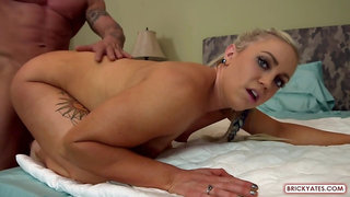 Incredible blonde bodybuilder is wearing a bikini and high heels and eagerly fucking a handsome guy