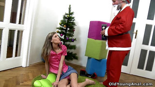Kinky old man in Santa costume fucks pretty hot teen and cums on her gaped anus