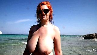 Curvy fat ass redhead mature mom teasing topless on the beach - public