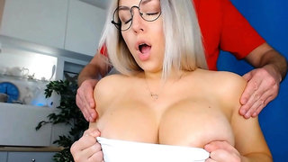Busty blonde with perky nipples does tit fuck
