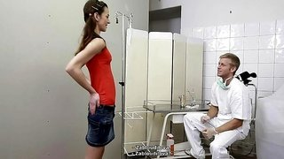 A cute chick gets naked to get an examination at the doctors office