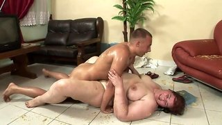 Obese brunette sucks young guy's dick after dinner