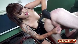 Brunette dominatrix dressed in sexy outfit humiliates her male sub
