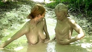 Covered in mud chicks touch each other beautiful bodies