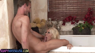 Busty massaging beauty grinds on cock