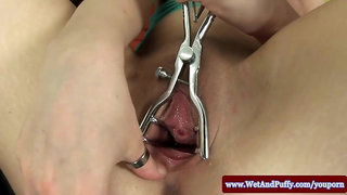 Puffy peach girl spreading with speculum