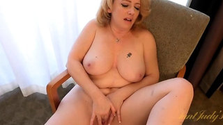 Mature babe in satin lingerie plays in a motel room - mature porno